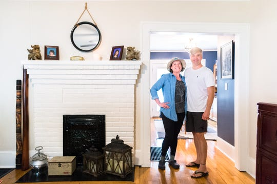 Amy Trujillo and her partner Jonathan Shane Coss in their home on Michigan Avenue in West Asheville which they purchased in December.