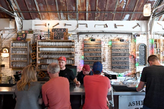 Diners order craft brews at Burial Beer Co. on Asheville's South Slope.