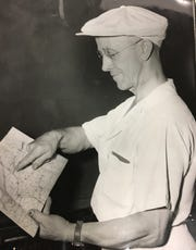 Jesse Hyde, a graduate of the Bunion Derby, examines a map for his trip to Columbus, Ohio, in 1947.