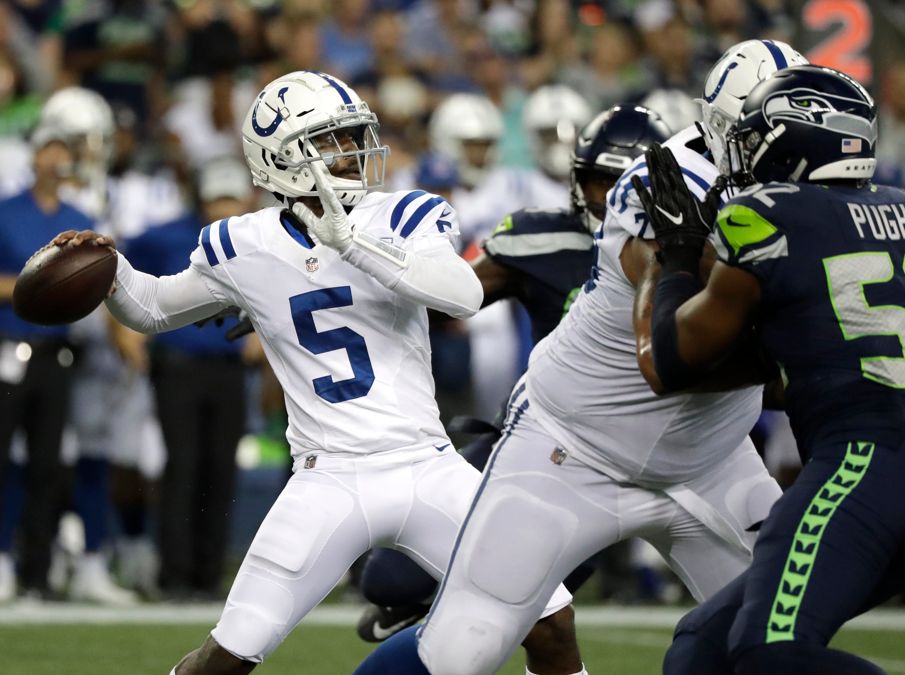 Indianapolis Colts quarterback Phillip Walker passes against the Seattle Seahawks during the second half of an NFL football preseason game, Thursday, Aug. 9, 2018, in Seattle. (AP Photo/Elaine Thompson)