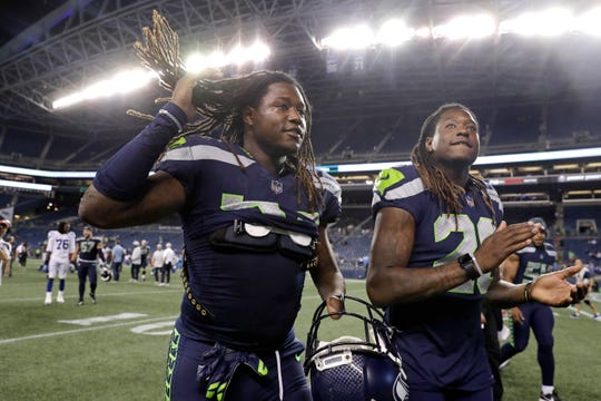 Seahawks twin brothers linebacker Shaquem Griffin, left, and cornerback Shaquill Griffin leave the field after their team's 19-17 loss ot the Colts in Thursday's preseason opener at Century Link Field. Shaqueem Griffin recorded tackles on his first four NFL snaps.