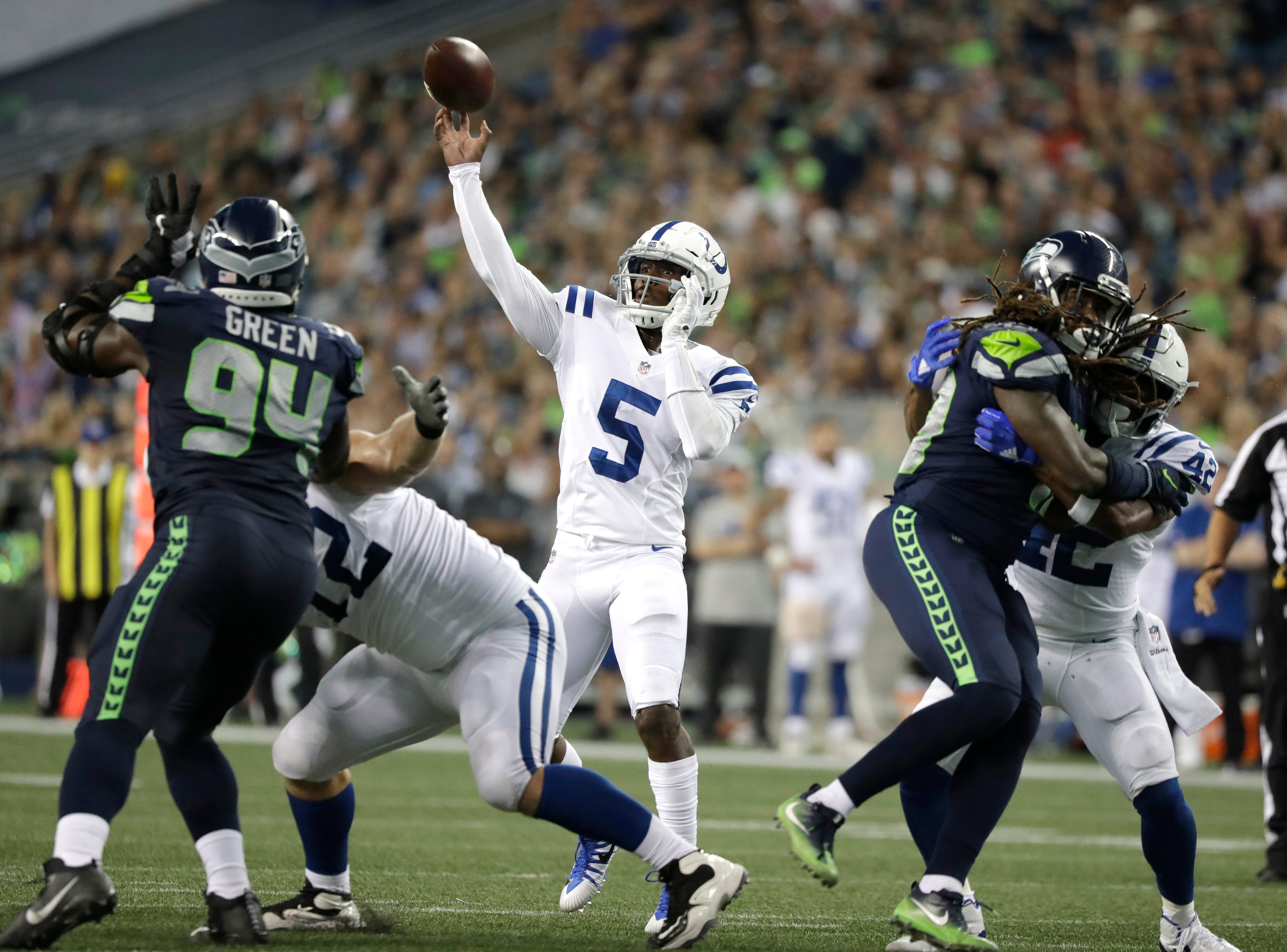 Indianapolis Colts backup quarterback Phillip Walker (5) throws a pass against the Seattle Seahawks during the second half of an NFL football preseason game Thursday, Aug. 9, 2018, in Seattle. (AP Photo/Elaine Thompson)