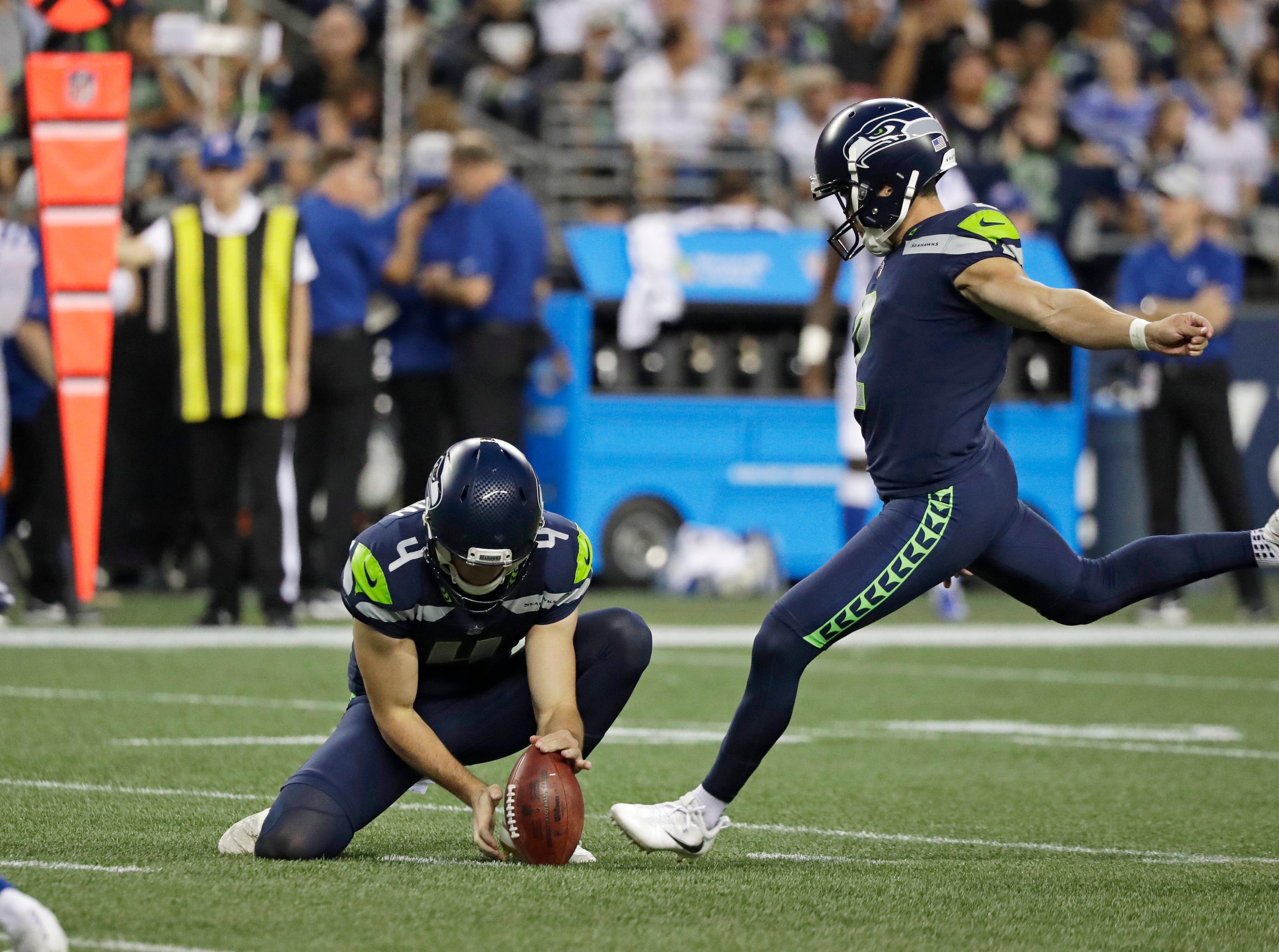 Seattle Seahawks' Jason Myers (2) kicks a field goal as punter Michael Dickson (4) holds during the second half of an NFL football preseason game against the Indianapolis Colts, Thursday, Aug. 9, 2018, in Seattle. (AP Photo/Elaine Thompson)