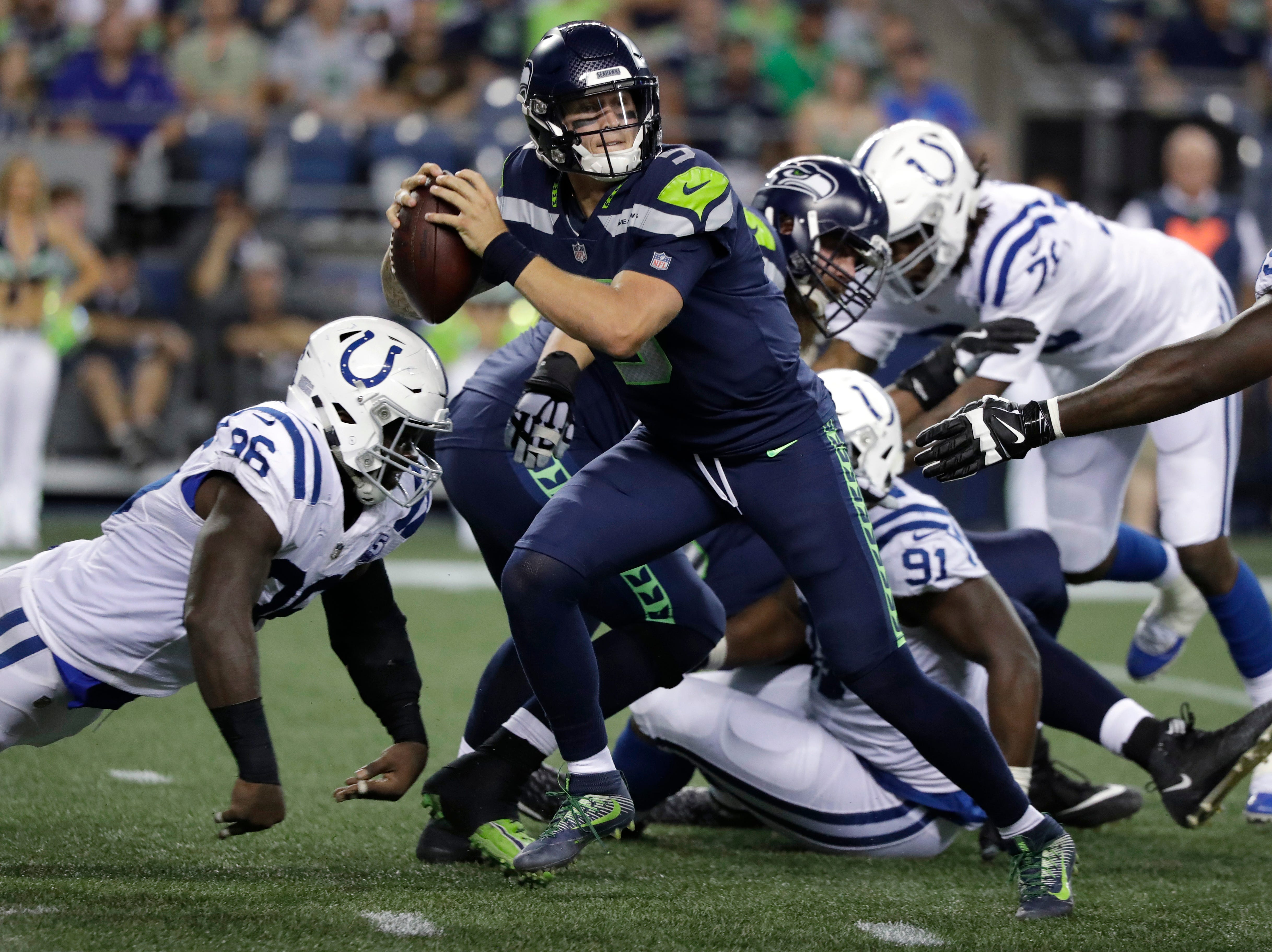Seattle Seahawks quarterback Alex McGough looks to throw against the Indianapolis Colts during the second half of an NFL football preseason game Thursday, Aug. 9, 2018, in Seattle. (AP Photo/Elaine Thompson)