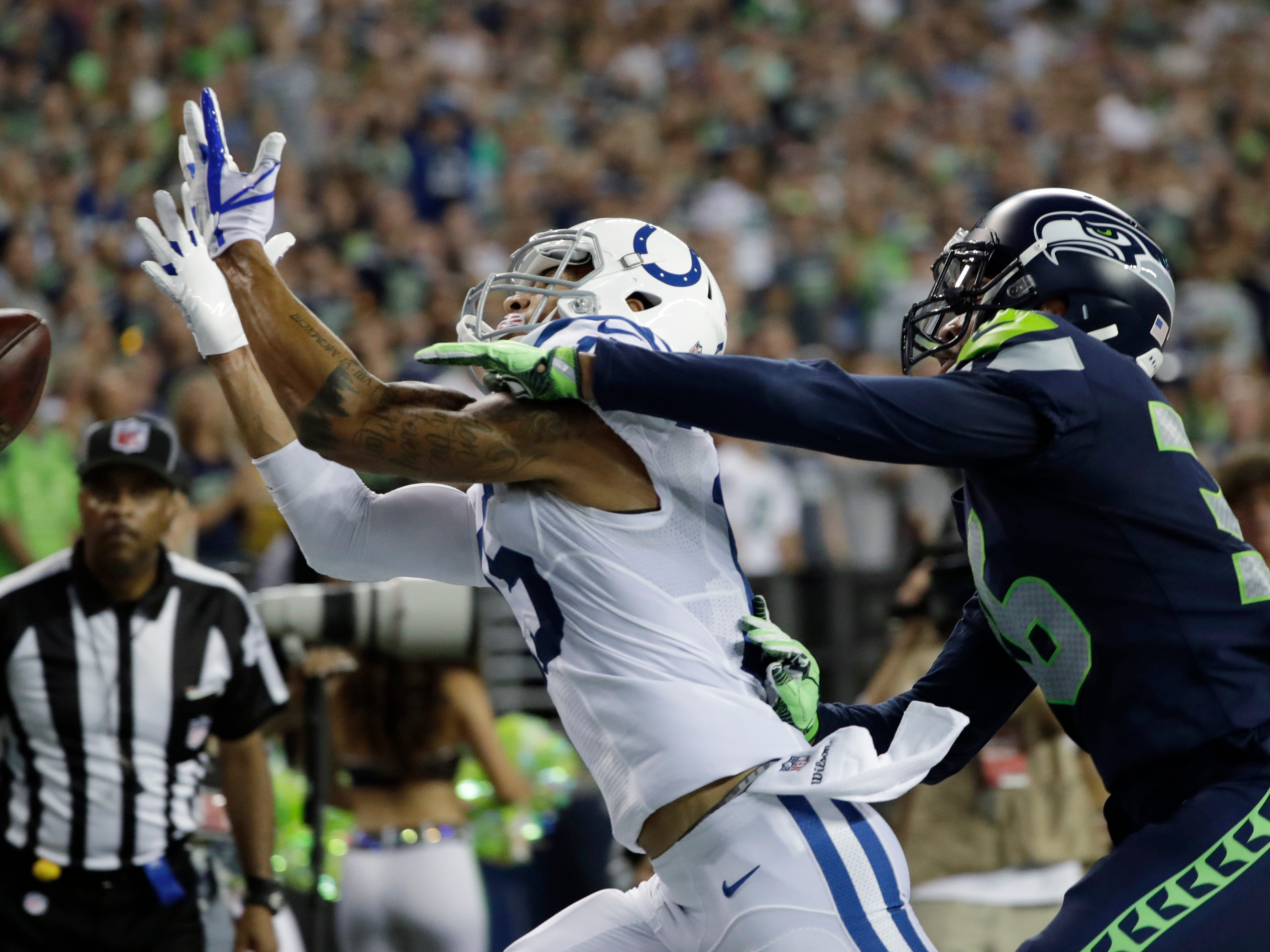 Seattle Seahawks defensive back Akeem King, right, breaks up a pass intended for Indianapolis Colts wide receiver K.J. Brent, left, during the second half of an NFL football preseason game, Thursday, Aug. 9, 2018, in Seattle. (AP Photo/Elaine Thompson)