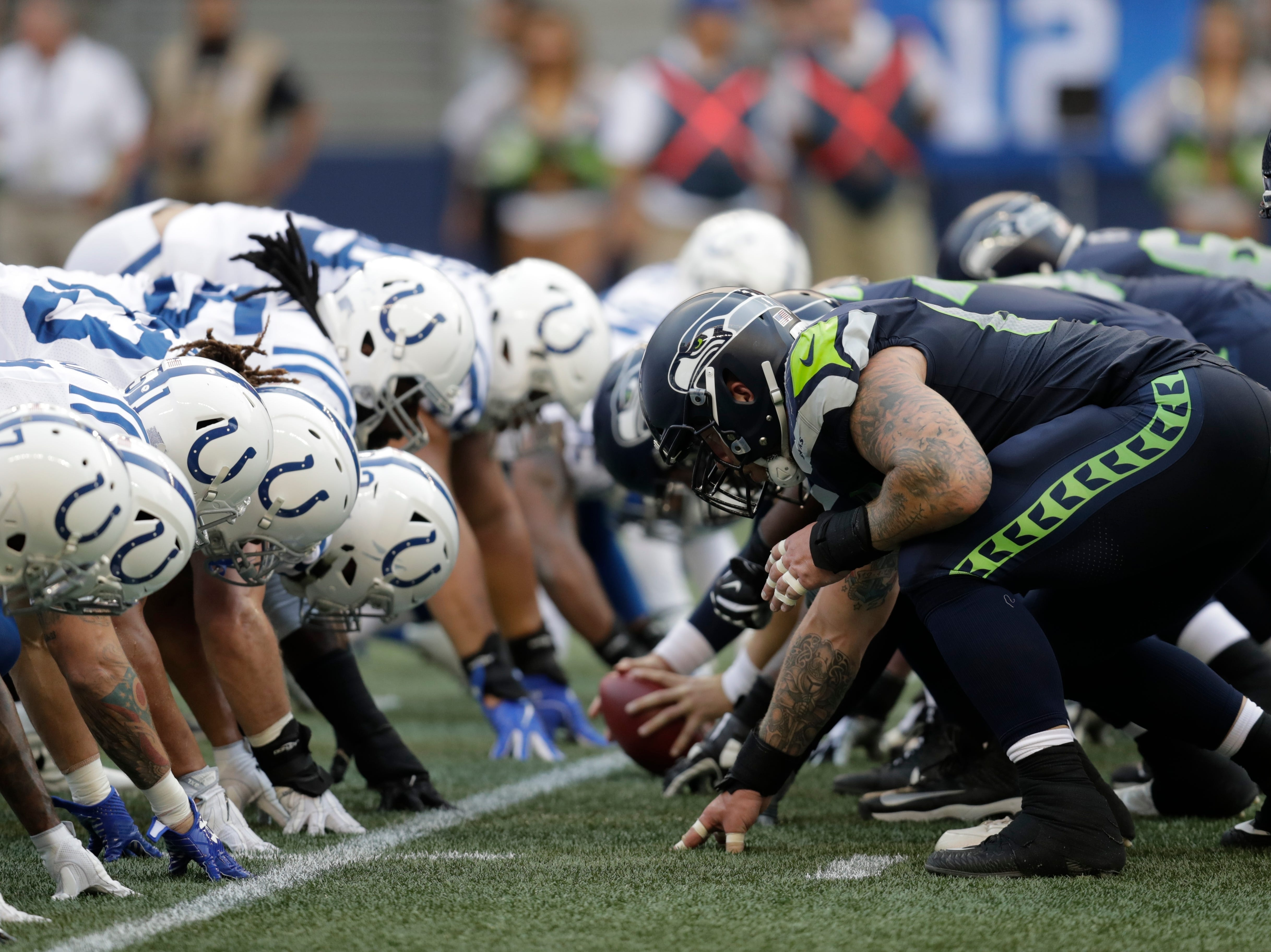 Seattle Seahawks and Indianapolis Colts players line up on the line of scrimmage during the first half of an NFL football preseason game, Thursday, Aug. 9, 2018, in Seattle. (AP Photo/Stephen Brashear)