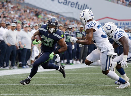 Rashaad Penny played in a Seahawks uniform for the first time Thursday, gaining 16 yards on eight carries.