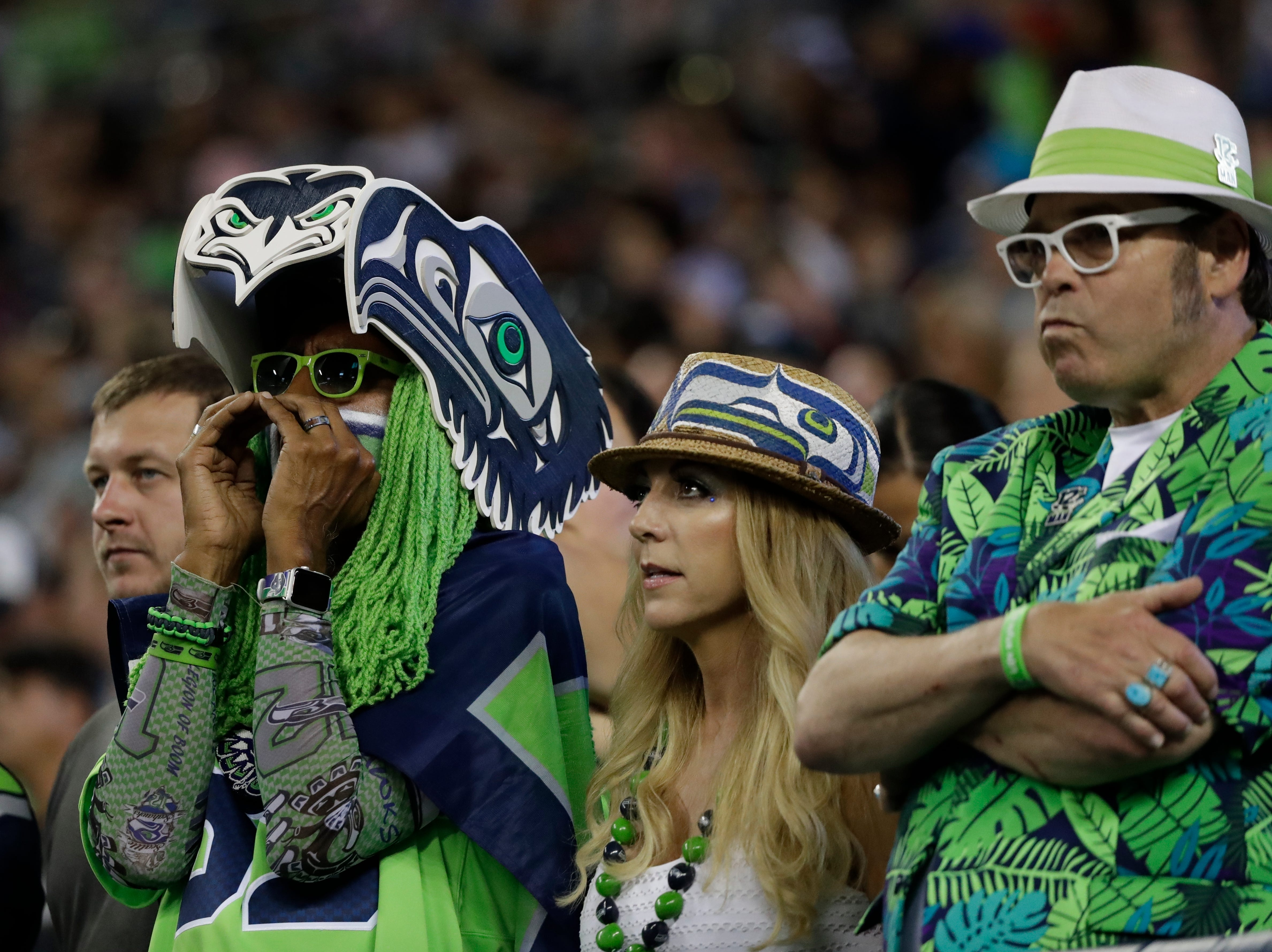 Seattle Seahawks fans watch during the second half of an NFL football preseason game against the Indianapolis Colts, Thursday, Aug. 9, 2018, in Seattle. (AP Photo/Elaine Thompson)