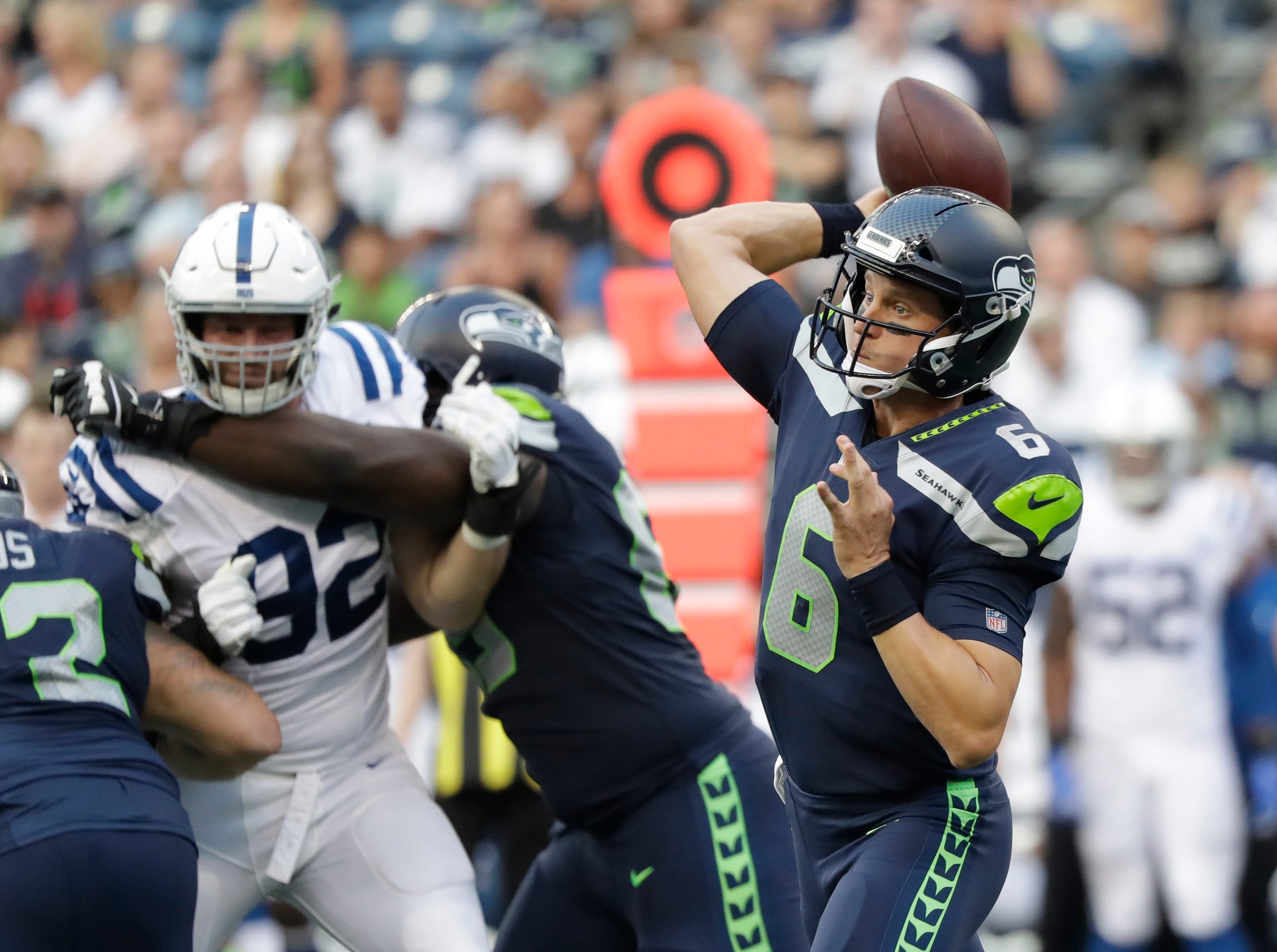 Seattle Seahawks quarterback Austin Davis passes against the Indianapolis Colts during the first half of an NFL football preseason game, Thursday, Aug. 9, 2018, in Seattle. (AP Photo/Elaine Thompson)