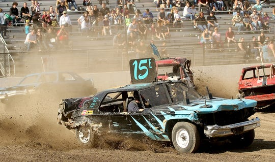 Dan Pieze drives his No. 15 car during a race for big cars during the June 23 Kitsap Destruction Derby at Thunderbird Stadium.