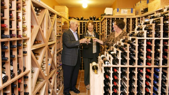 Harry and Wendy brandon, with Fran Delisle,Executive Director of the BSO, in the wine cellar.