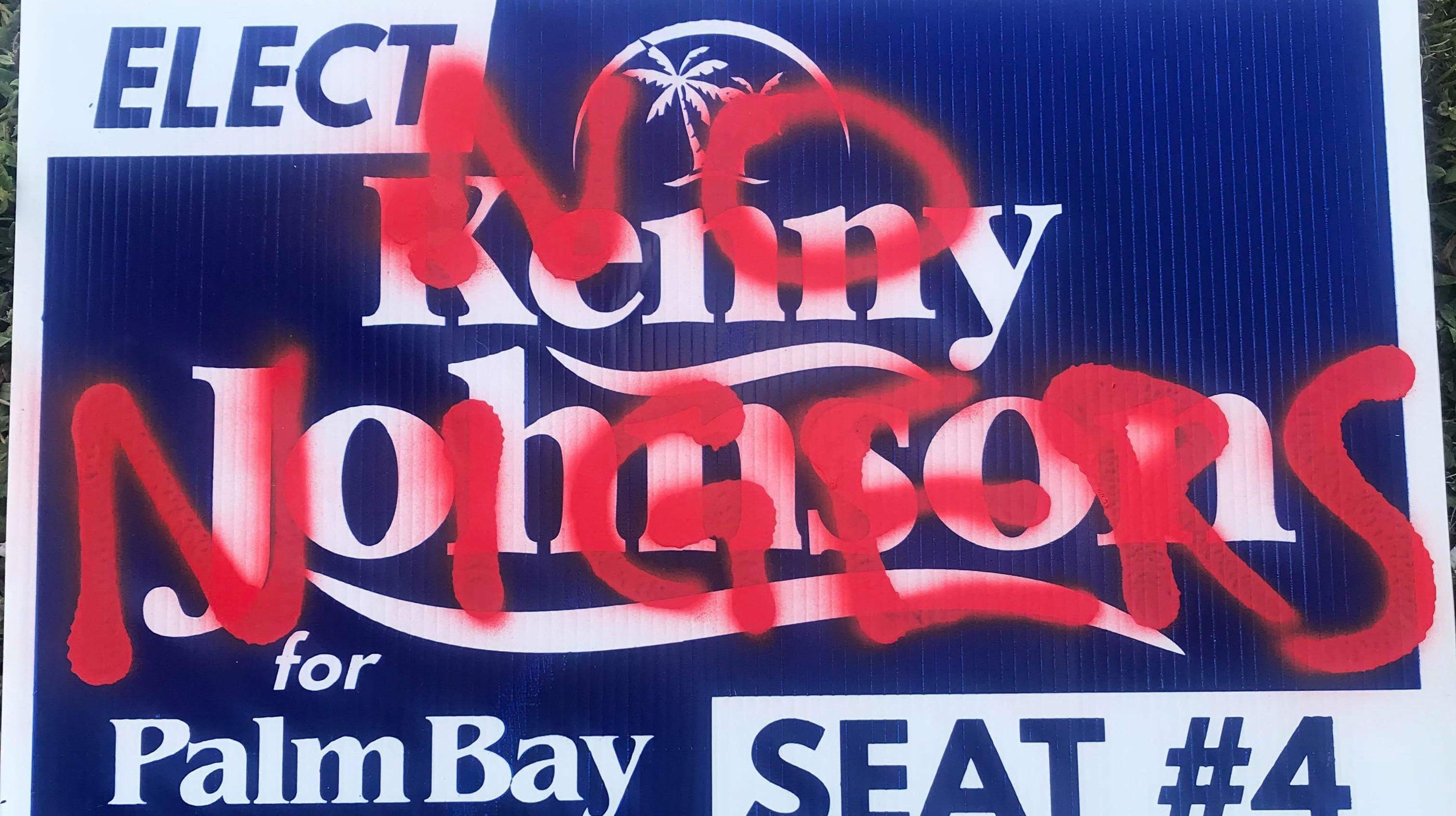 Kenny Johnson's campaign yard sign was spray-painted near the intersection of Minton Road and Jupiter Boulevard in Palm Bay.