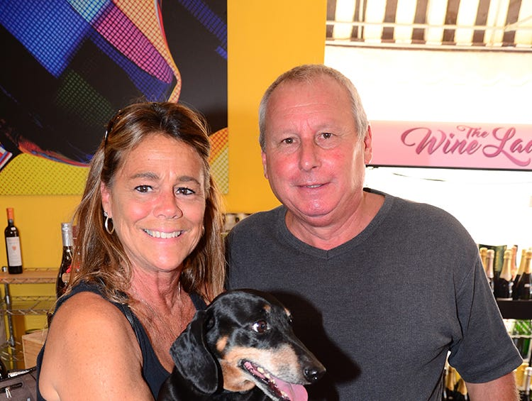Michelle Strickland, Gus, and Ricky Capellaro stopped in at The Wine Lady in Cocoa Village Saturday afternoon as Tails at the Barkery hosted a benefit for the Florida Dachshund Rescue.
