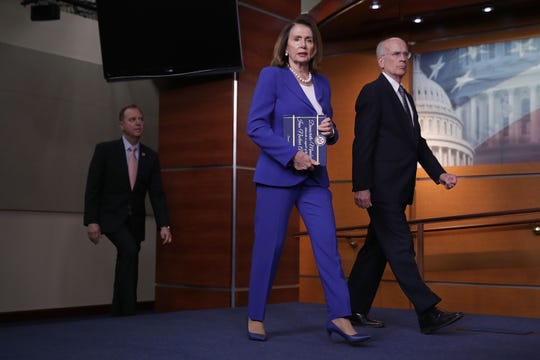 House Minority Leader Nancy Pelosi (D-CA) (C) carries a book of statements of support for the 2015 Iran nuclear deal as she and Rep. Peter Welch (D-VT) arrive for a news conference in the U.S. Capitol Visitors Center May 10, 2018 in Washington, DC. Pelosi and House Democratic leaders were critical of President Donald Trump's decision to pull out of the nuclear agreement with Iran, saying the United States is isolated and that war in the Middle East is more likely.  (Photo by Chip Somodevilla/Getty Images)