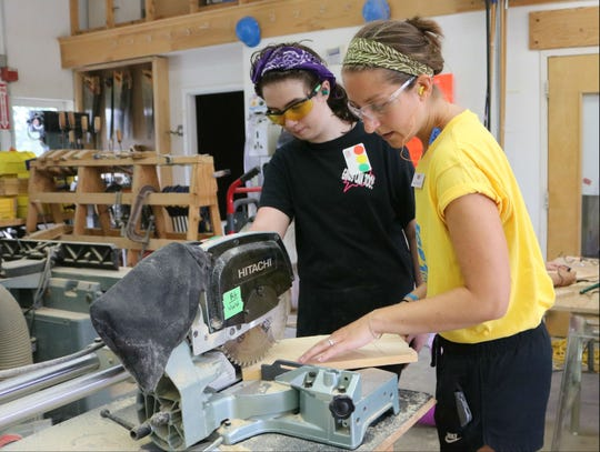 Shannon Esrich, on the right, is Vermont Works for Women Rosie's Girl coordinator. She worked with students on Aug. 9, 2018 at one of the camp locations at the Center for Technology in Essex.