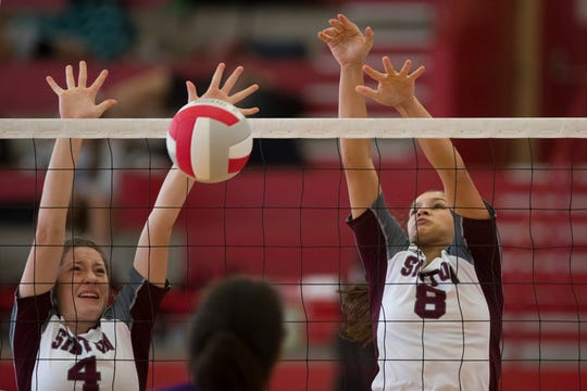 Sinton's  Anna Thomas (left) and Autumn Moses block a ball in a CCISD Spikefest Volleyball Tournament on Friday, August 10, 2018 at Ray High School