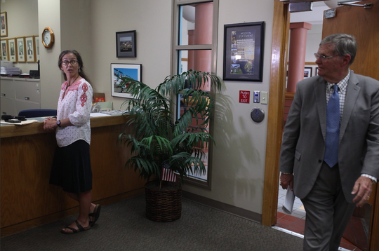 Aislynn Campbell, at left, files paperwork at City Hall to unseat Corpus Christi Mayor Joe McComb, at right, on Aug. 8, 2018.