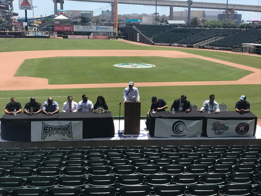 """Representatives from the Hooks, CCC Entertainment, KeepPunching Entertainment and boxers Selina """"Aztec Queen"""" Barrios, Justin """"Jawbreaker"""" Jones and Ernest Reyna gather during the news conference to announce a seven-bout card at Whataburger Field in September on Friday, Aug. 10, 2018"""