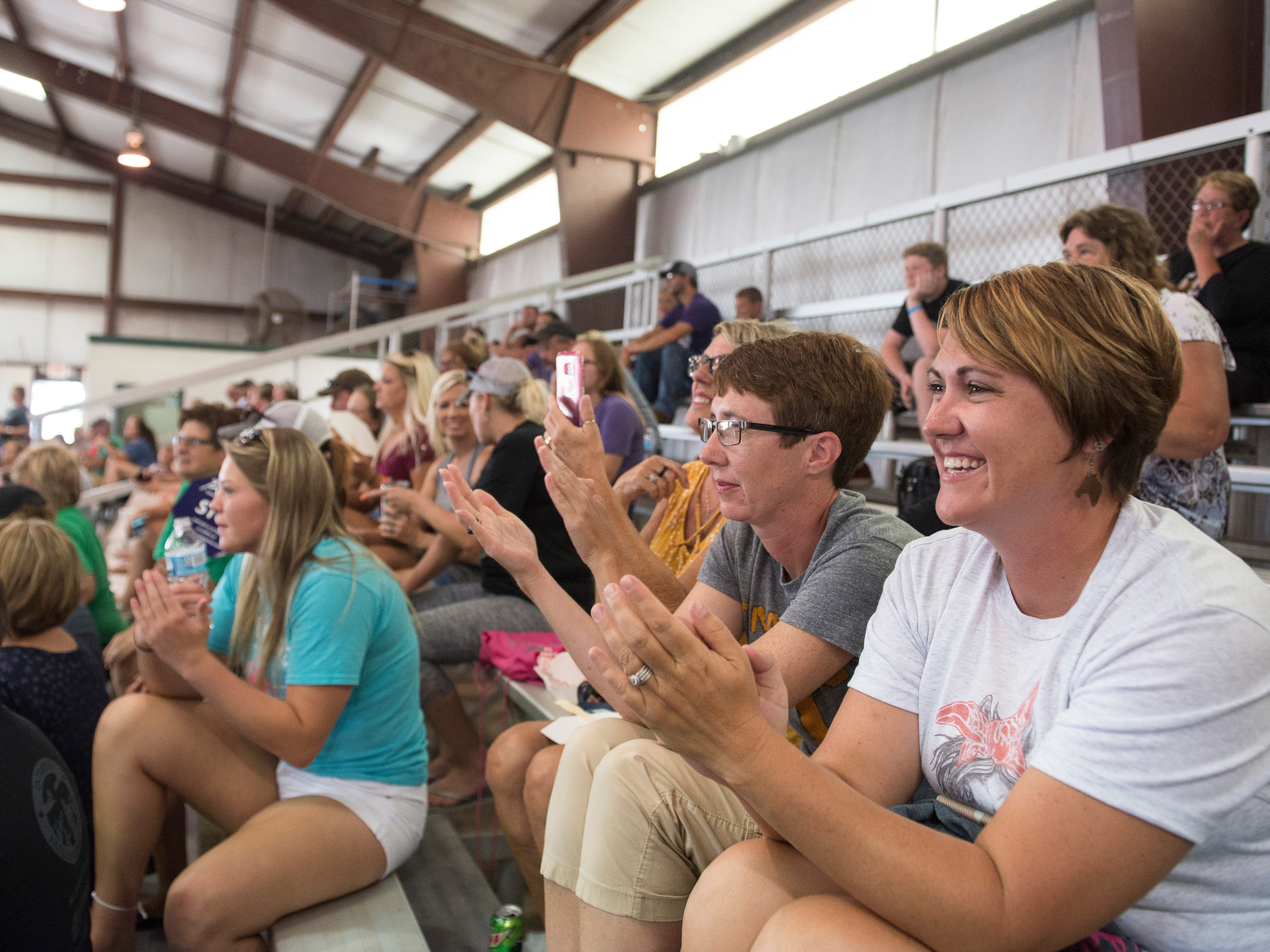 Fair attendees clap at the conclusion of the Showman of Showmen Contest in Large Animals at the Ross County Fair on August 10, 2018, in Chillicothe, Ohio.