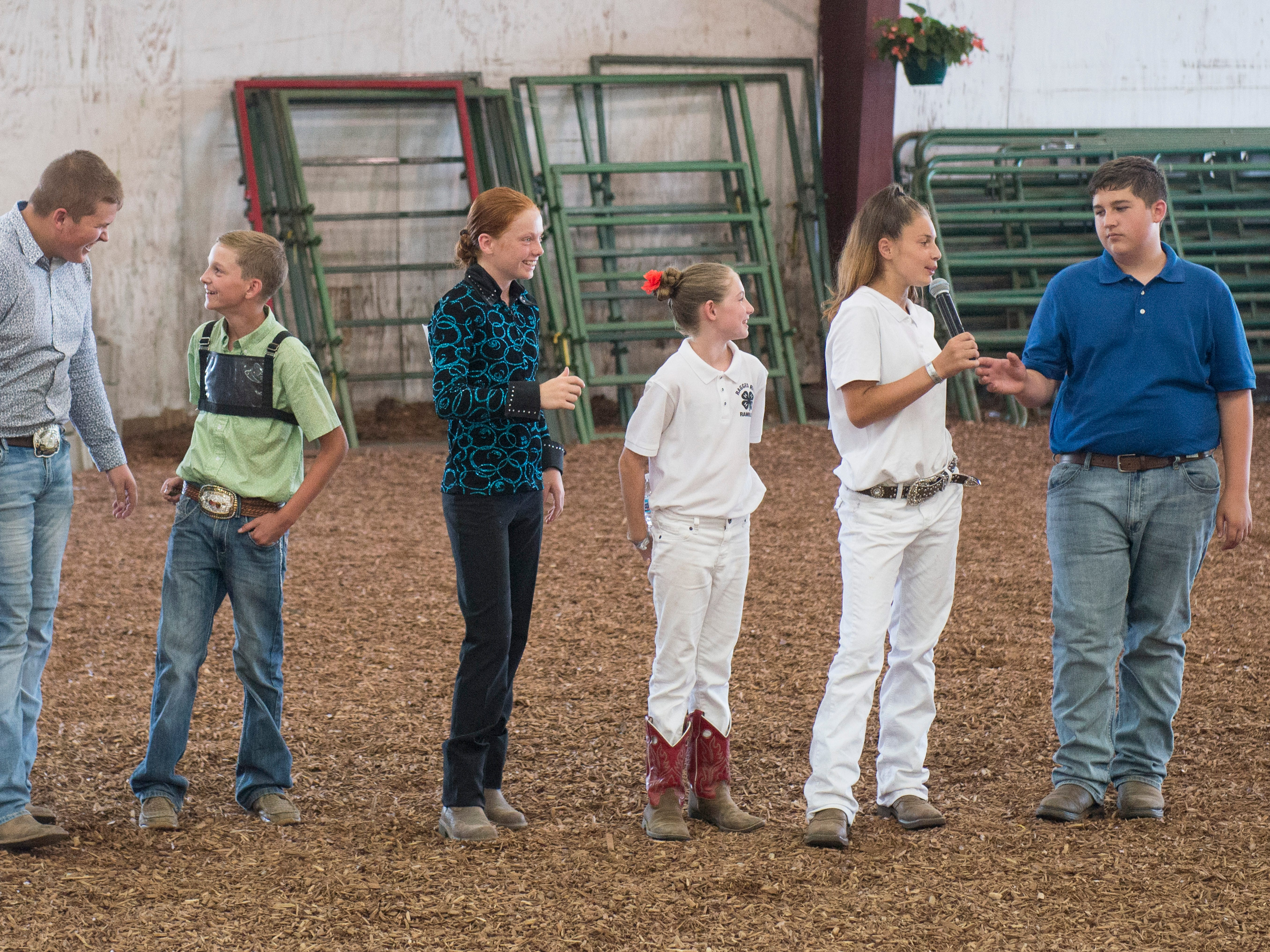 Contestants introduce themselves to the crowd during the Showman of Showmen Contest in Large Animals at the Ross County Fair on August 10, 2018, in Chillicothe, Ohio.