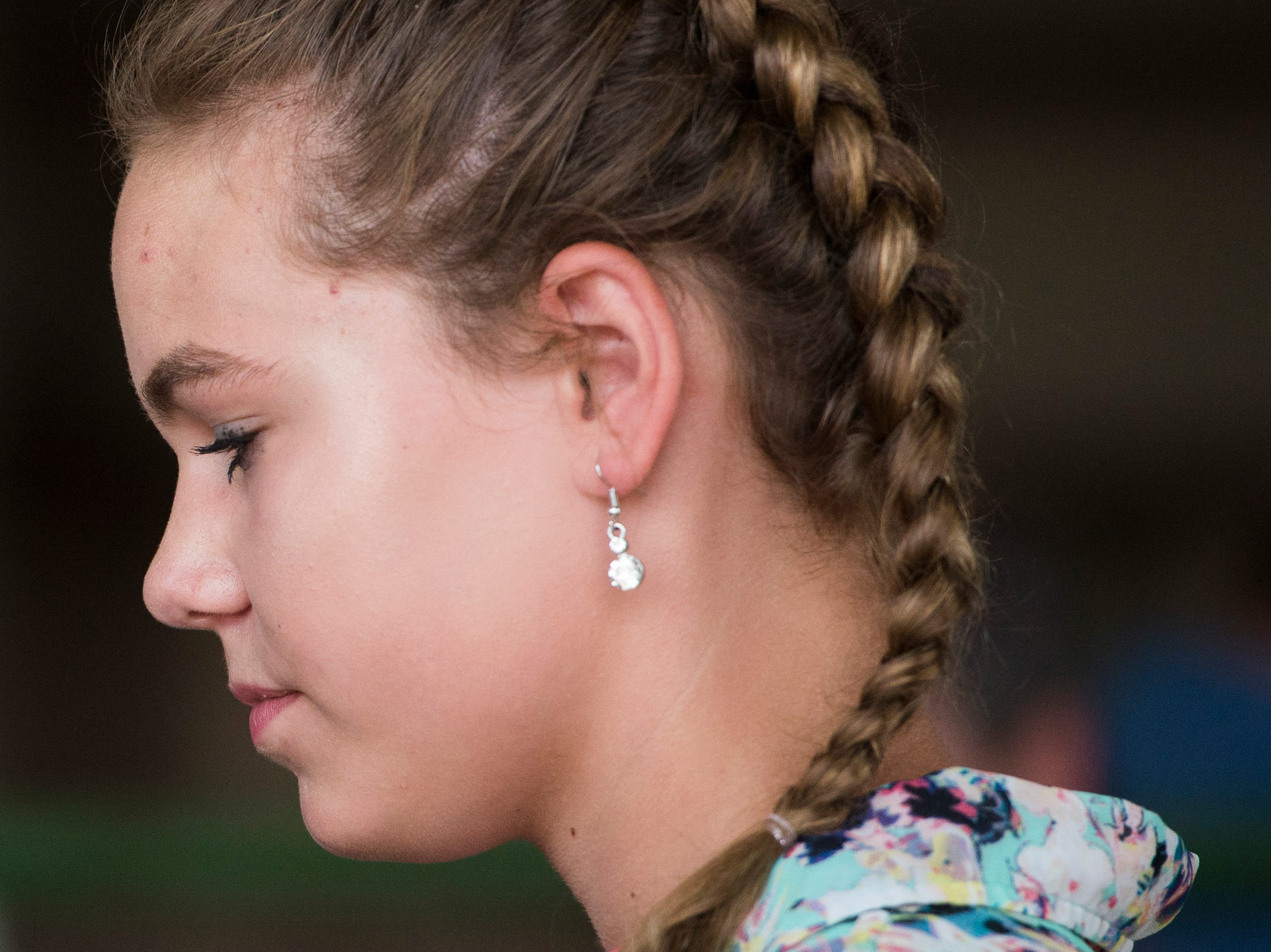 Jenna Schoebelock, intermediate contestant, reflects during the Showman of Showmen Contest in Large Animals at the Ross County Fair on August 10, 2018, in Chillicothe, Ohio.