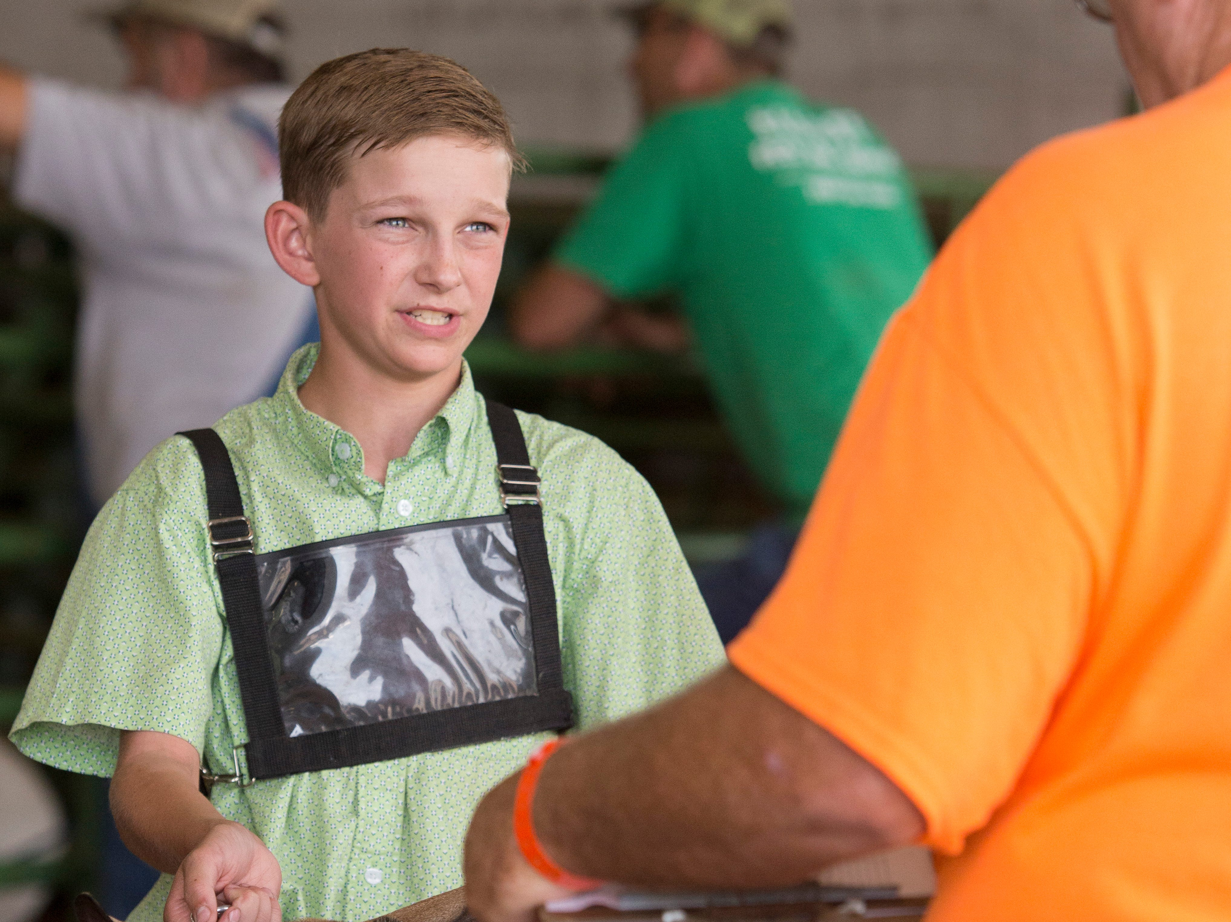 Hudson Drake, intermediate contestant, answers questions about goats during the Showman of Showmen Contest in Large Animals at the Ross County Fair on August 10, 2018, in Chillicothe, Ohio.