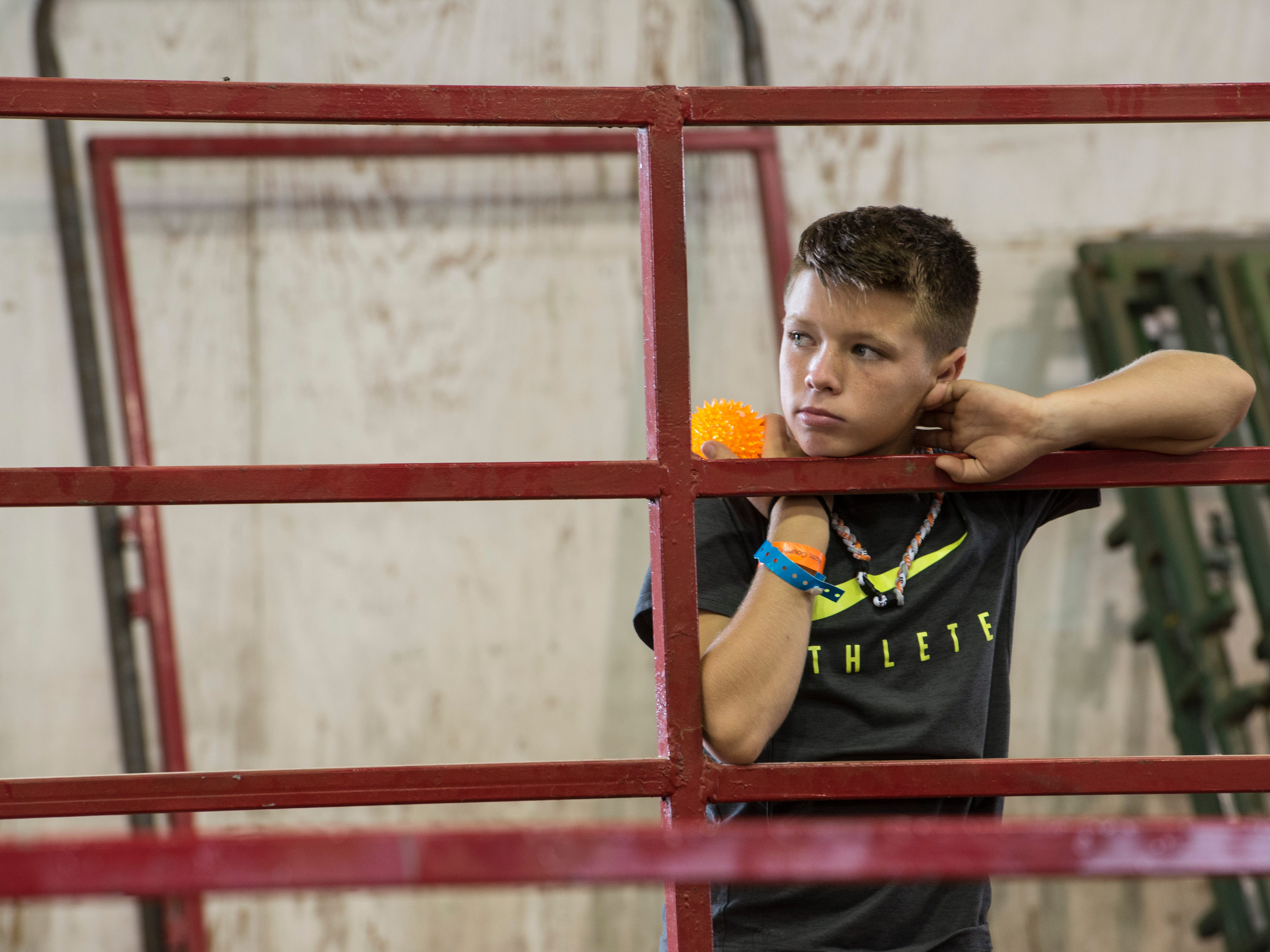 A young fair attendee looks on during the Junior Fair Swine Sale at the Ross County Fair on August 9, 2018 in Chillicothe, Ohio.