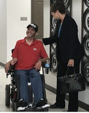 Ohio Supreme Court Justice Sharon Kennedy meets a veteran at the Chillicothe VA's Freedom's Path apartment complex during a tour of the facility Friday morning.
