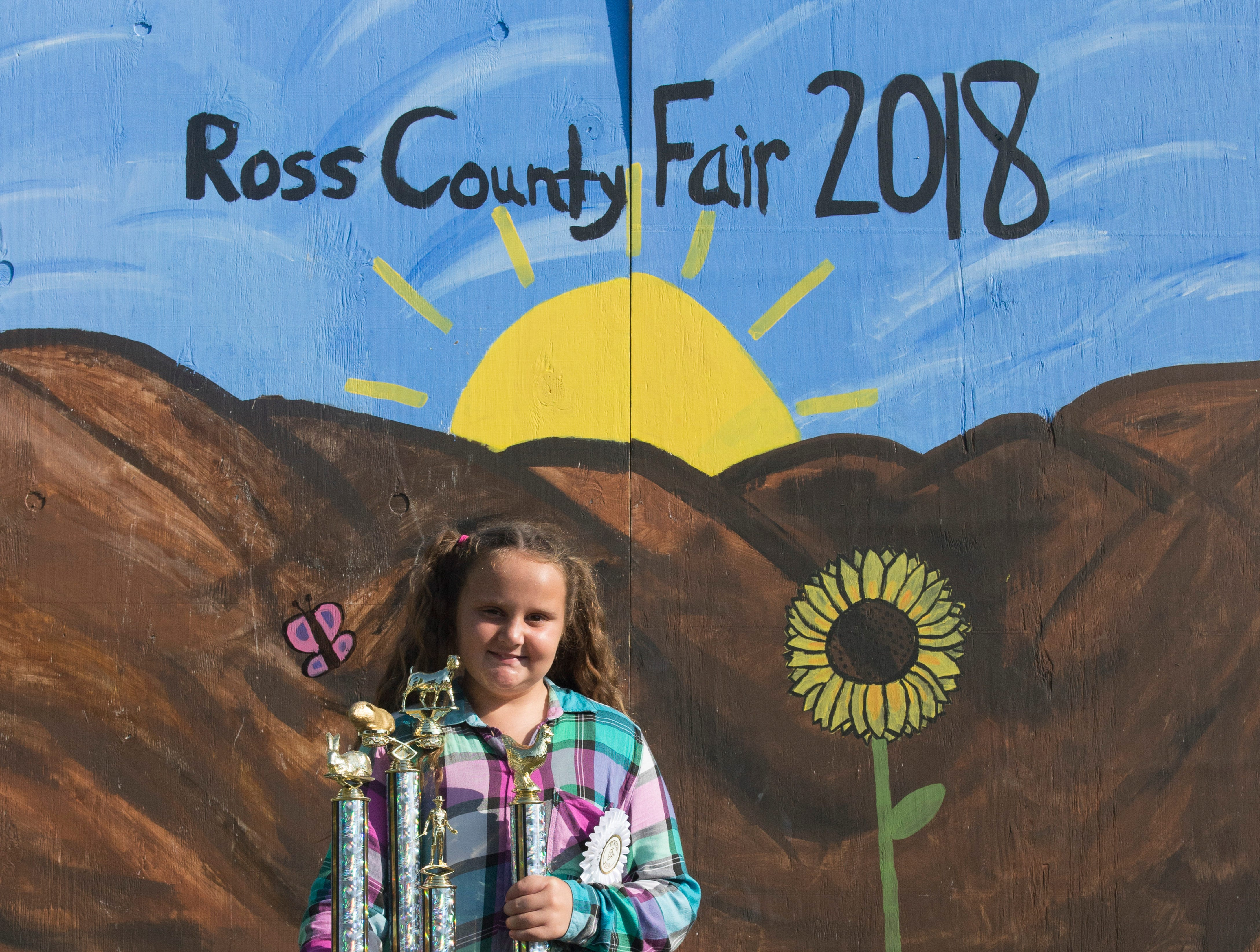 Cambriana Rittinger, 9, poses with her trophy after being awarded the title of First Place in the Junior category for the Small Animal Showman of Showmen Contest at the Ross County Fair on August 9, 2018 in Chillicothe, Ohio.
