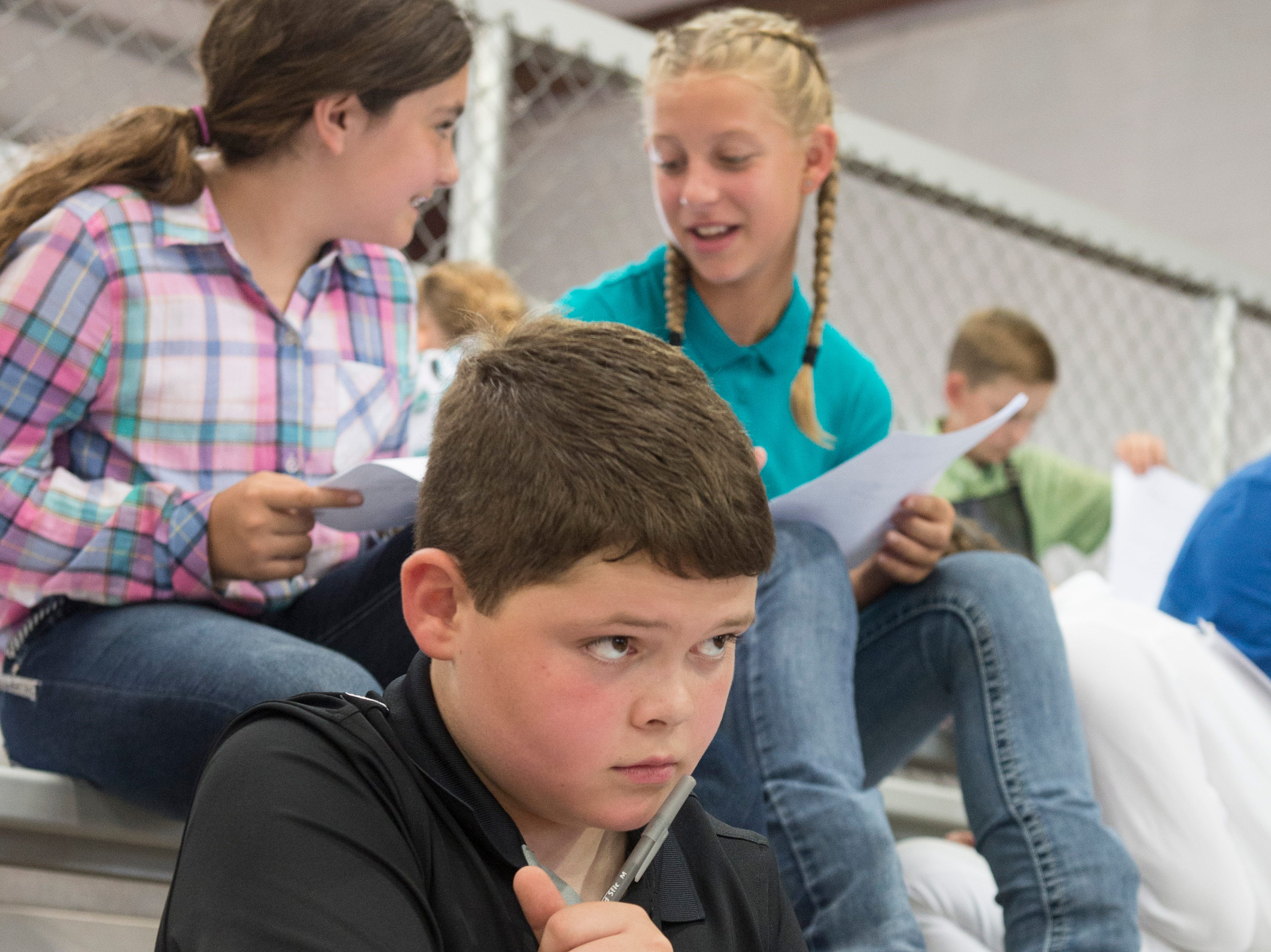 Hayden Good pauses for a moment during the written swine exam during the Showman of Showmen Contest in Large Animals at the Ross County Fair on August 10, 2018, in Chillicothe, Ohio.