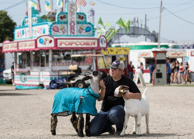 Aaron Yoakum poses with his goat Star and his sheep Shaun at the 2018 Ross County Fair.