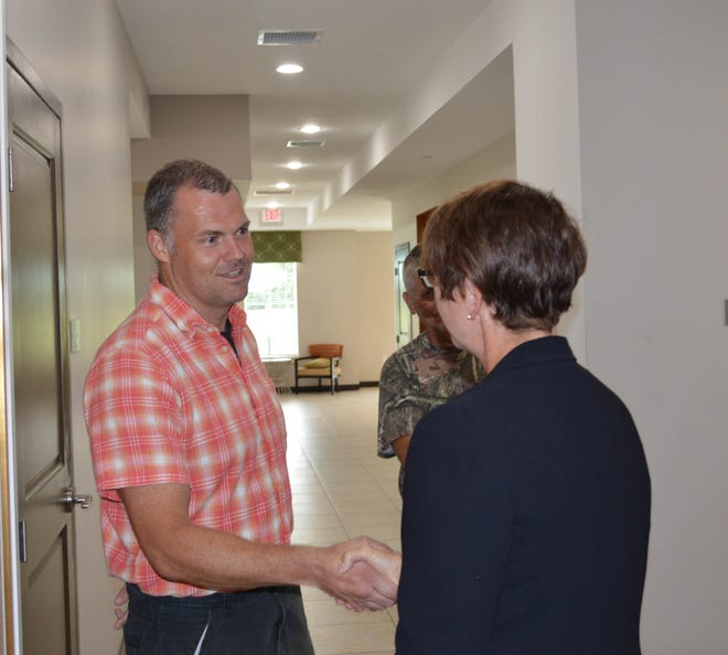 Ohio Supreme Court Justice Sharon Kennedy (R) shakes hands with Marine Corps veteran Keith Kavanaugh during a tour of Freedom's Path, a residential facility for veterans, at the Chillicothe VA Friday morning. Her visit was part of a tour to Ohio VA facilities for the Veterans Justice Outreach Program initiative.