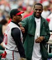 Cleveland Cavaliers' LeBron James, right, and Cincinnati Reds ' Ken Griffey Jr. share a laugh before the Reds play the Cleveland Indians Saturday, June 12, 2004, in Cleveland.