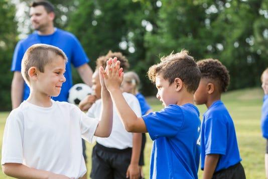 Children S Soccer Team Good Sportsmanship High Fives