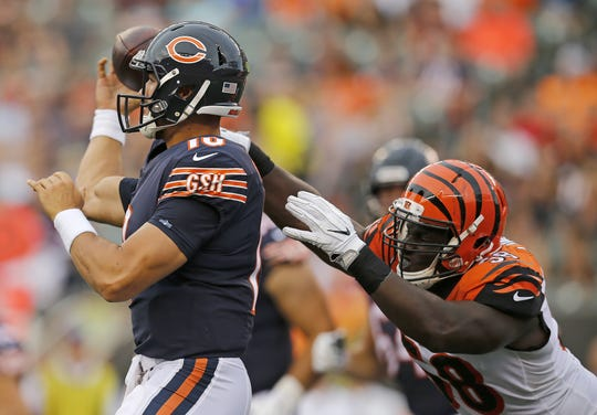 Cincinnati Bengals defensive end Carl Lawson (58) breaks up a pass attempt by Chicago Bears quarterback Mitchell Trubisky (10) in the first quarter of the NFL Preseason Game One between the Cincinnati Bengals and the Chicago Bears at Paul Brown Stadium in downtown Cincinnati on Thursday, Aug. 9, 2018.