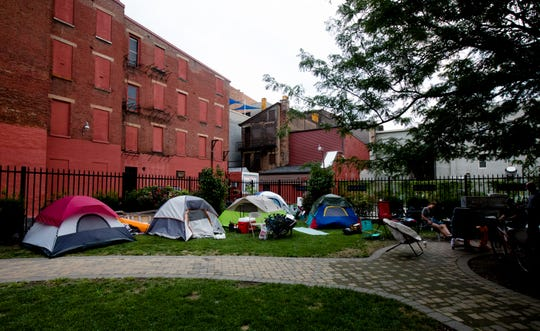 Tents are set up in a homeless encampment on Friday, Aug. 10, 2018 off of 13th street in Over The Rhine.