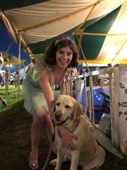 Helen Newbold dressed as Tinker Bell alongside her fairy dog.