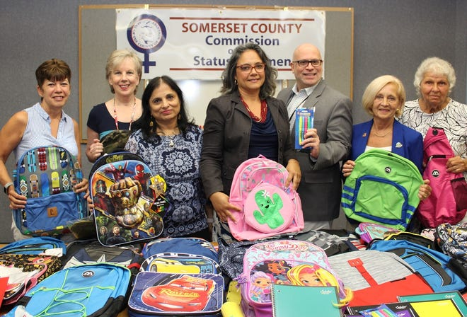 Schoolsupplies collected through Project First Class were presented by the Somerset County Commission on the Status of Women to Feeding Hands Inc. Executive Director Lois Bennett (left)and Food Bank Network Executive Director Marie Scannell (right). Joining in the presentation were SCLSNJ Human Resources & Payroll Associate Charlene Perkins, Commissioner Smriti Agrawal, Project First Class Chair Stella Ayala, SCLSNJ Director of Public Services Chris Korenowsky, and Freeholder Pat Walsh.