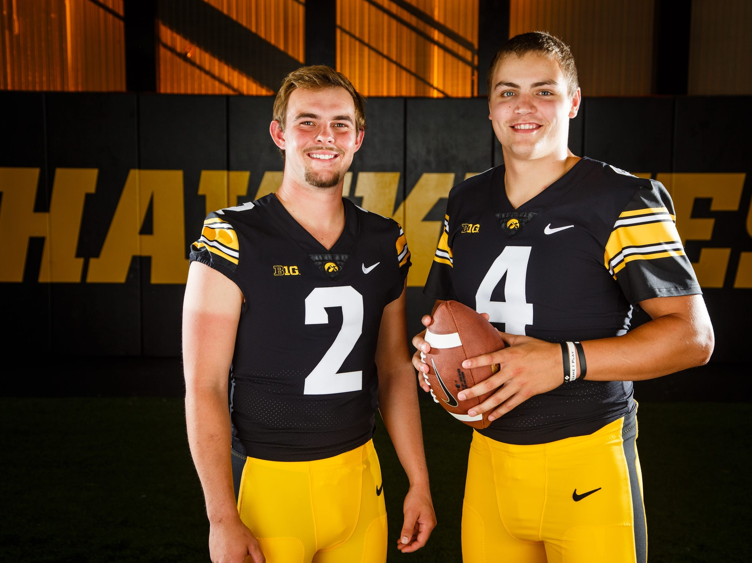 Iowa's Peyton Mansell, left, and Nate Stanely, right, pose for a photo during the Iowa Football media day on Friday, Aug. 10, 2018 in Iowa City.
