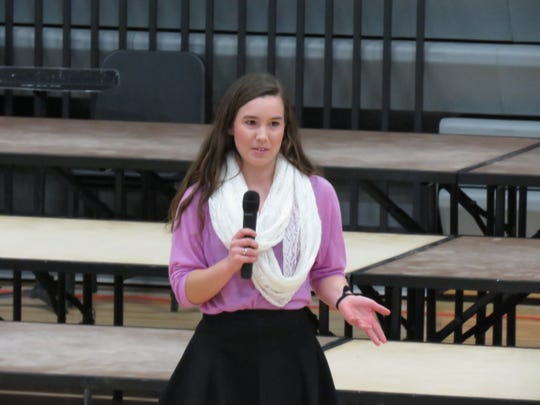 """Senior Mollie Tibbetts performs her original oratory """"A Lesson in Love"""" that earned her a trip to the state speech competition."""