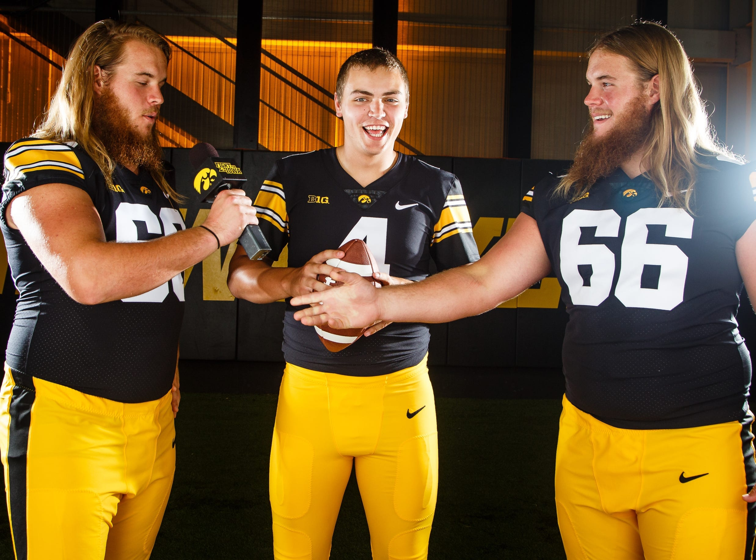 Iowa's Landan Paulsen, left, Nate Stanely, center, and Levi Paulsen, right, joke around during the Iowa Football media day on Friday, Aug. 10, 2018 in Iowa City.