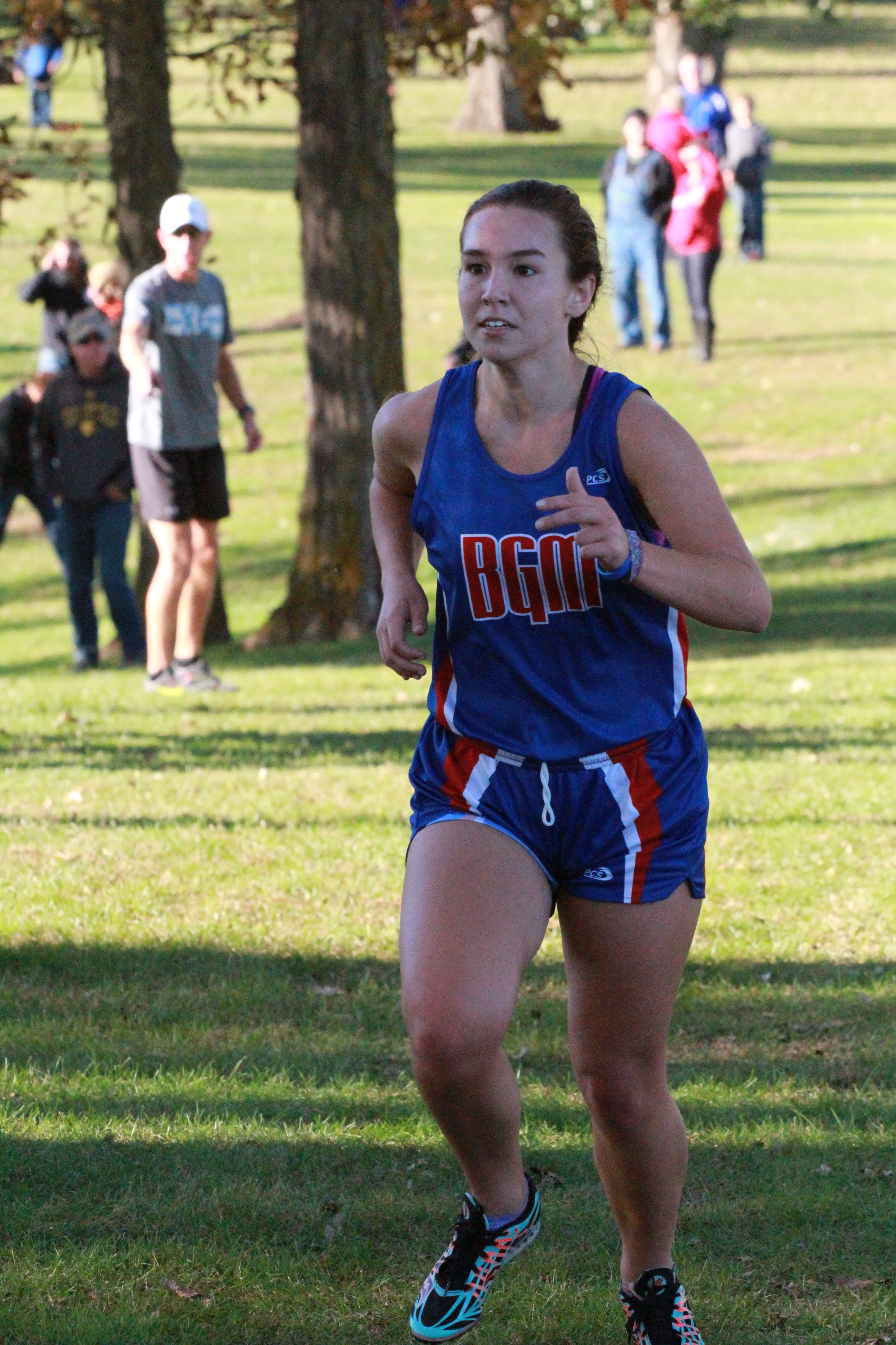 Mollie leads her team to third place in a high school cross country meet.
