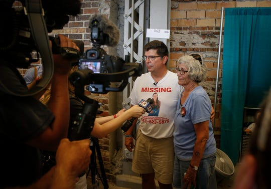 Rob Tibbetts, left, the father of Mollie Tibbetts, and Rob's aunt Mary K. Tibbetts, speak to media on Friday, Aug. 10, 2018, during the Iowa State Fair in Des Moines.