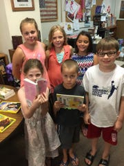 A group of young readers was excited to paw through the new books donated to Linden Public Library.