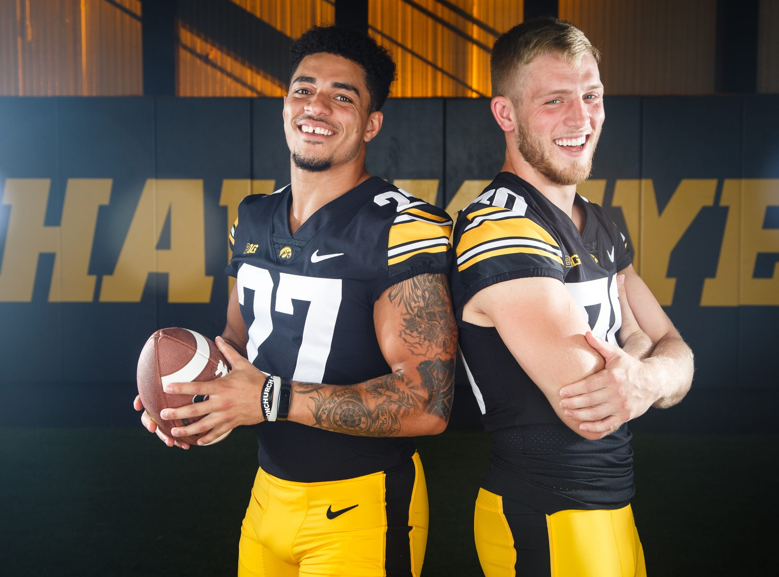 Iowa's Amani Hooker, left, and Jake Gervase, right, pose for a photo during the Iowa Football media day on Friday, Aug. 10, 2018 in Iowa City.