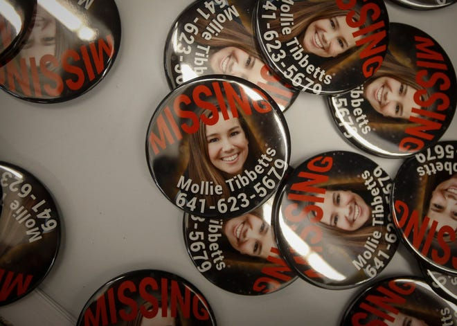 Buttons of Mollie Tibbetts were available for people to take on Friday, Aug. 10, 2018, during the Iowa State Fair in Des Moines.