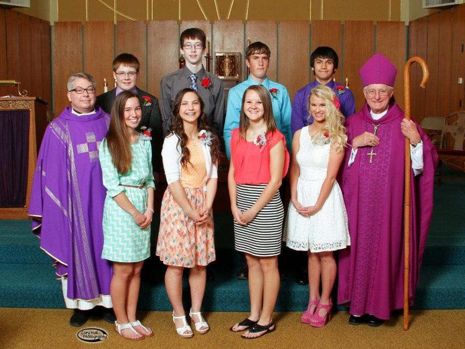Confirmation was celebrated at St. Patrick Church in Brooklyn on Wednesday, April 1, 2015. Pictured are, from left, front row: the Rev. Brian Shepley, Mollie Tibbetts, Hope Beck, Gracie Hawkins, Autumn Waterbeck, Bishop Martin Amos. Back row: Dillon Brady, Eoin Lyons, Owen Cline and Jesus Gamboa.