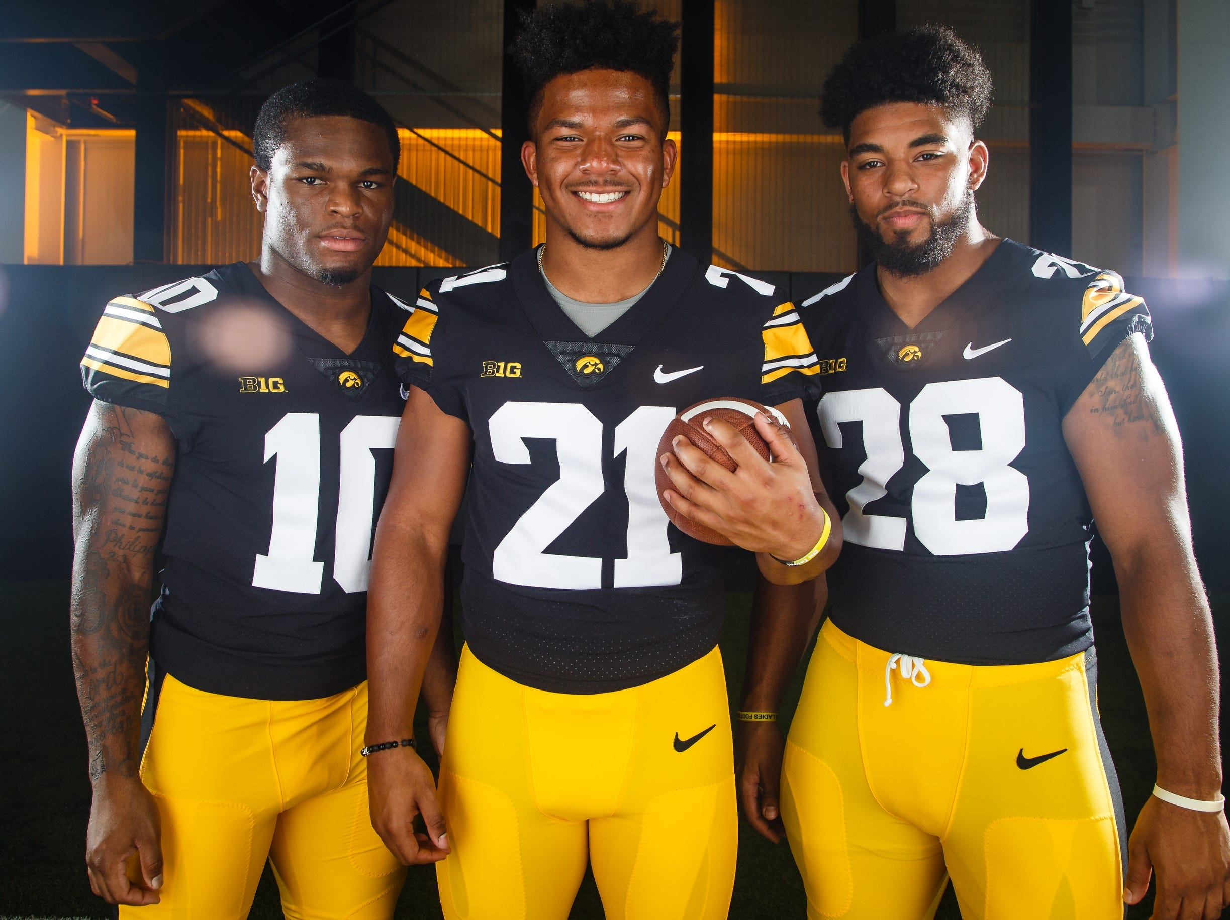 Iowa's Mekhi Sargent, left, Ivory Kelly-Martin, center and Toren Young, right, pose for a photo during the Iowa Football media day on Friday, Aug. 10, 2018 in Iowa City.