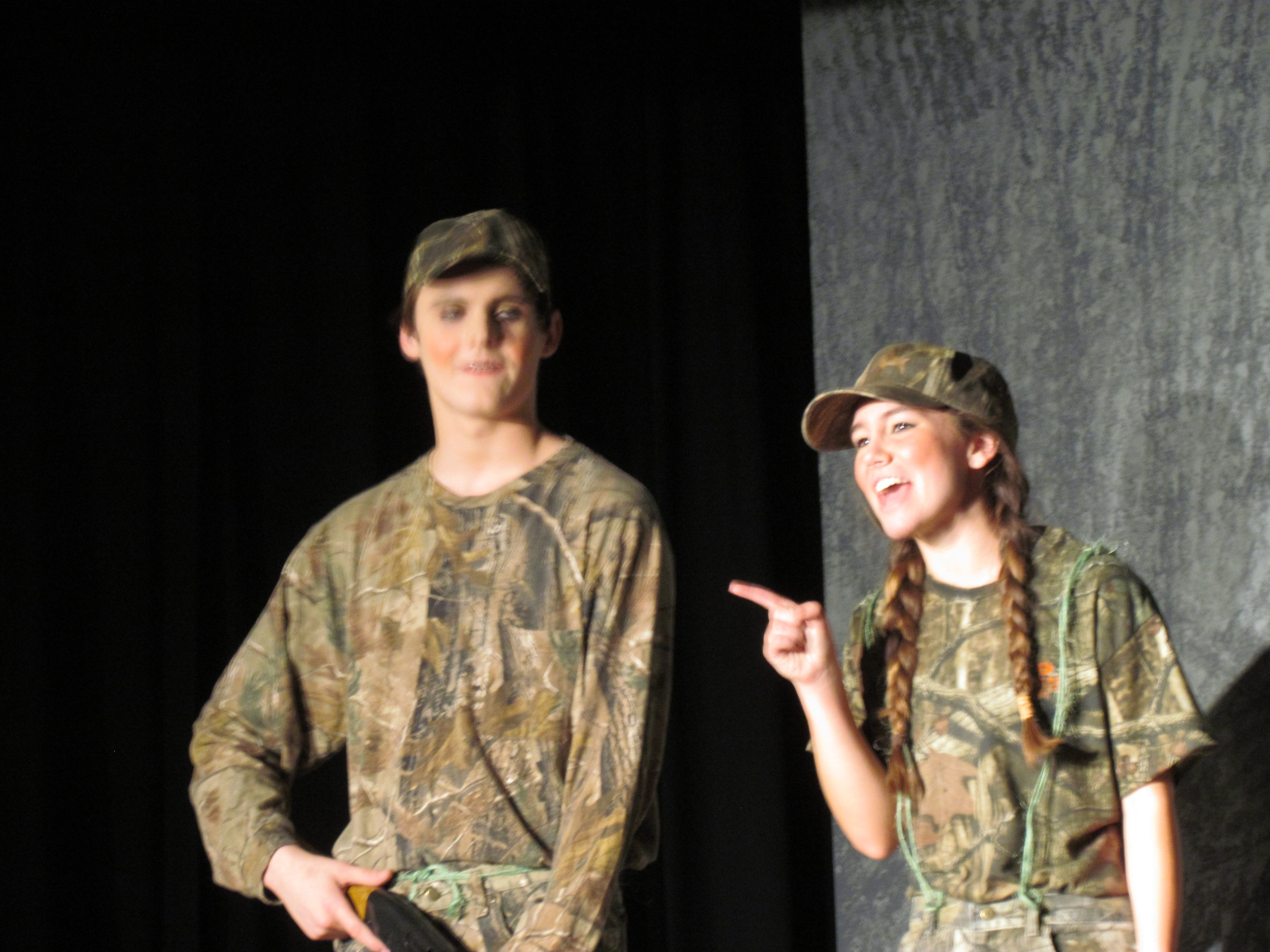 Betsy (Mollie Tibbetts) points out that she and Bubba (Cody Sicard) were out hunting when out of nowhere presents fell from the sky.