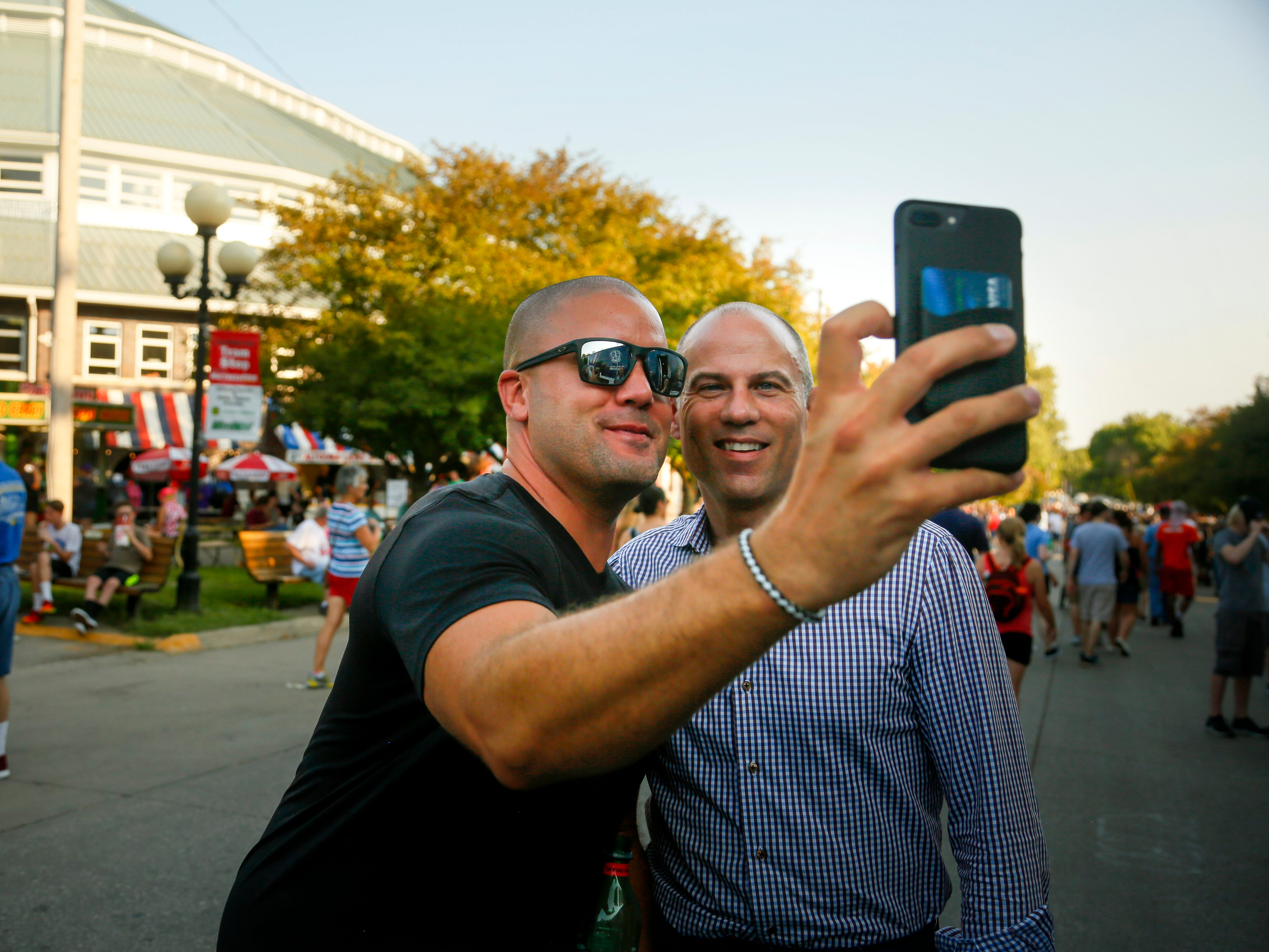 Michael Avenatti, the lawyer known for representing adult film actress Stormy Daniels in her case against President  Donald Trump poses for a selfie at the Iowa State Fair Thursday, Aug. 9, 2018.